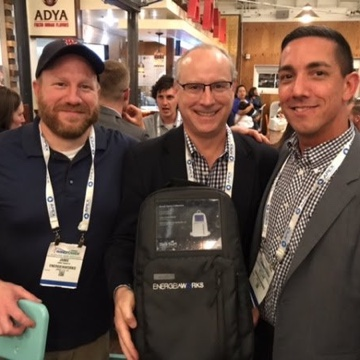 Jamie shares an EnergeiaWorks solar backpack with another lucky winner